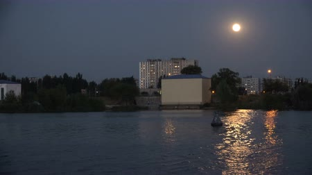 rosszkedvű : city in the evening twilight with water in the rays of the moon