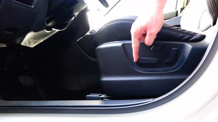 ayarlanabilir : demonstration of the horizontal adjustment of the drivers seat of the car Stok Video