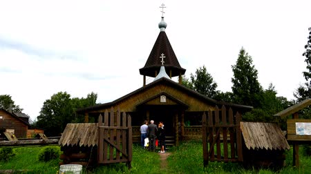 wieża : people near the entrance to the village church