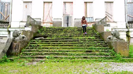 kolumny : lonely girl down the grass-covered steps