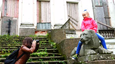 old times : mother photographs daughter in an abandoned stone ruins