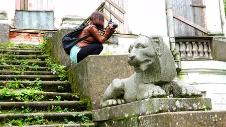 old times : girl collects photographic material in the historic ruins
