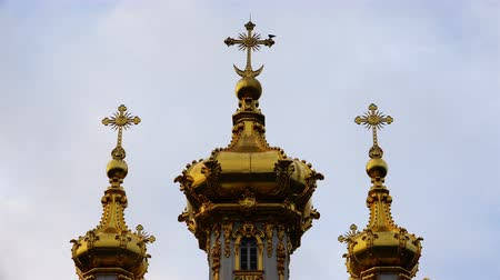 plated : three Golden domes with Orthodox crosses at the peak