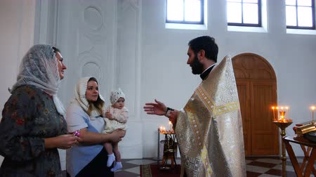 christening : the priest speaks before the rite of baptism
