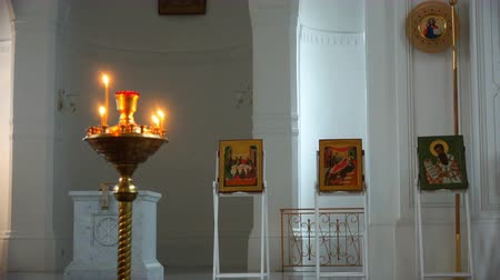 посвящение : sacred icons in the church on the background of burning bells.