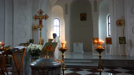 православие : the priest performs a sacred rite in the church