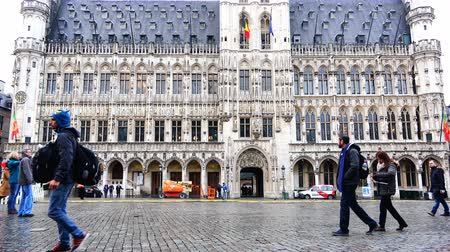 administracja : Belgium, November 24, 2017, Brussels Grand Place Plaza, an ancient government building with flags on the central square of the city