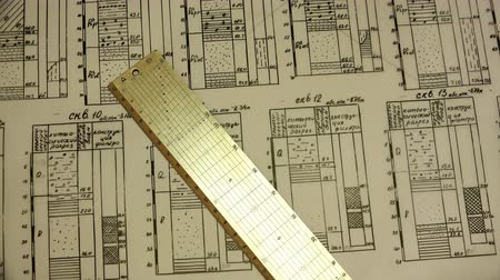 enrolado : the engineer put the ruler on the tracing paper and folded the drawing into a bundle. Stock Footage