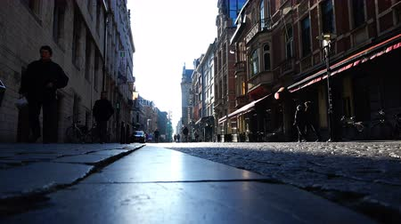 paving : Belgium, 22 November 2017, Leuven, glare of light on a small and narrow cobblestone street Stock Footage