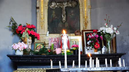 haven : burning candle near icons in the Church. Stock Footage