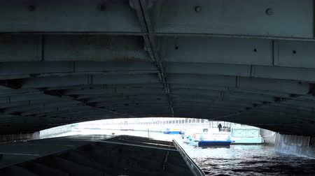 picturesque view : Russia, May 2, 2018 Petersburg a motor ship with a glass roof passes under the old iron bridge Stock Footage