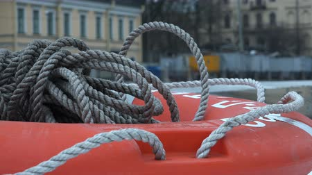 lifebuoy : red life ring with a rope on the ship.