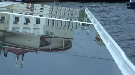 neva river : reflection of buildings and structures of the city from the glass roof of the ship.
