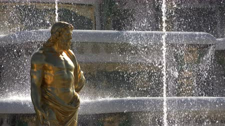 st petersburg : golden statue on the background of a fountain.