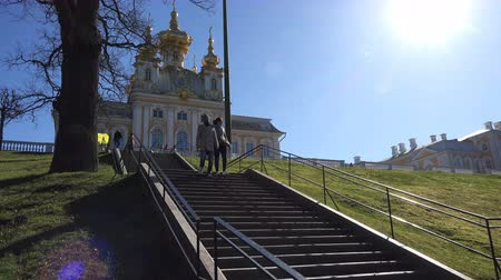crypt : Russia, May 09, 2018, Peterhof a young couple goes down the stairs from the palace. Stock Footage