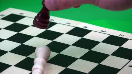 riskantní : black queen on a chessboard chopping a white king.