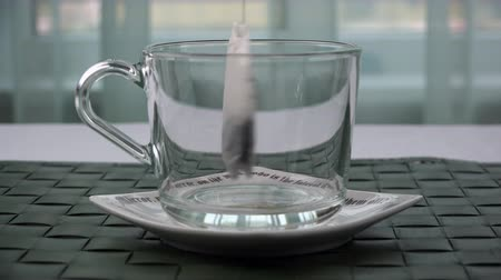 teabag : a bag of tea leaves is placed in a transparent cup.