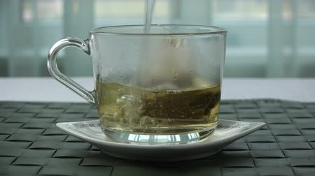 teabag : Pour boiling water over a bag of tea in a cup. Stock Footage