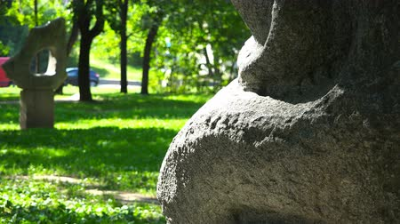 archeologie : forest park urban area with stone figures.