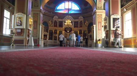 murals : Russia, July 16, Vyborg secret rite of baptism in the Orthodox Church Stock Footage