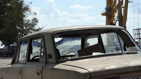вандализм : Russia, July 16, Vyborg raked car with broken windows on the roadway Стоковые видеозаписи