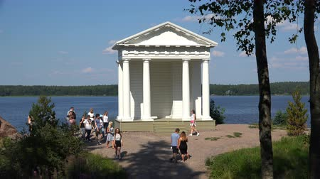 Финляндия : Russia, July 16, Vyborg Tourists at the Temple of Neptune in Mon Repos Park Стоковые видеозаписи