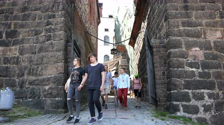 valoun : tourists walking through the ancient fortress of knights times