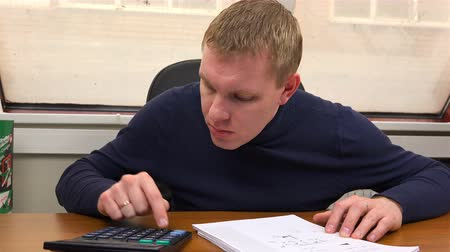 bonus : The specialist performs the calculation on the calculator according to the drawing. Stock Footage