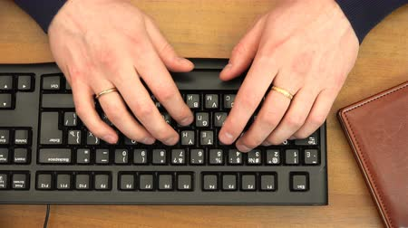 presleme : fingers typing on the keyboard by pressing buttons.