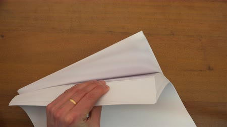 bürokrasi : left hand turns over empty sheets of paper.