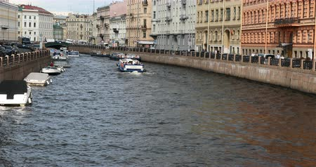 griboedova : Russia, St. Petersburg, September 02, 2018 pleasure boats with tourists cut through the channel waves.