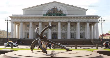 architectural protection : Russia, St. Petersburg, September 02, 2018 anchor lies on the background of the building of the Spit of Vasilyevsky Island.