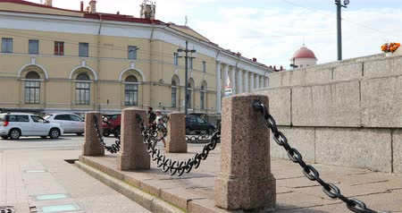 architectural protection : chains sag to asphalt in the town square.