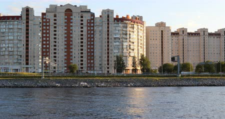 neva river : view from the river to the high-rise buildings.