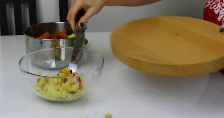 aromatik : Russia, St. Petersburg, October 08, 2018 the girl pours the sliced potatoes in a transparent bowl Stok Video
