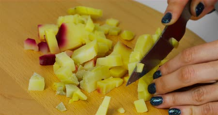 grated : boiled potatoes cut into cubes for salad. Stock Footage
