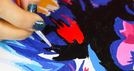 expressionism : female hand draws a vivid picture,