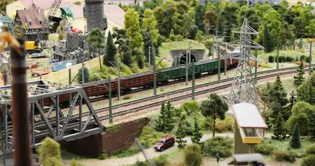 private museum : Russia, St. Petersburg, September 29, 2018 freight train loaded with coal and rubble leaves for the forest thicket Stock Footage
