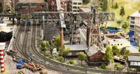 construction crane : Russia, St. Petersburg, September 29, 2018 train movement on a detailed model of a coal factory Stock Footage