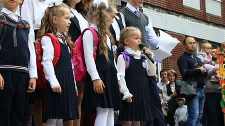 first class : Russia, St. Petersburg, September 1, 2018 The first-grader is reciting the poem on her first school assembly