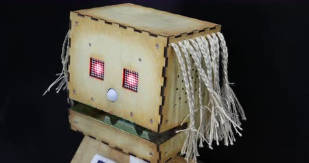 soška : Wooden robot with artificial intelligence and red eyes.