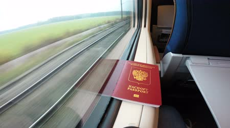 pas : The passport is lying near the window in the train.