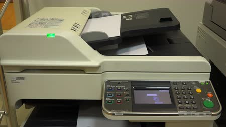 impressão digital : a copier copies documents on a multifunction device. Stock Footage