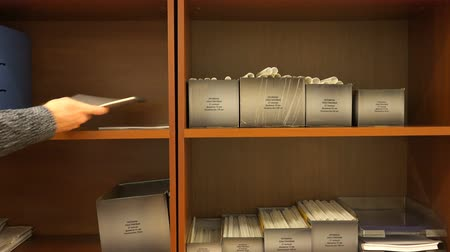 post room : documents neatly folded on a shelf.