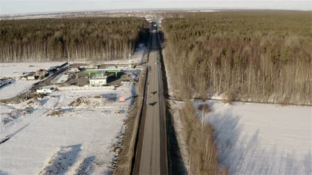 Car traffic on the winter highway. Stock mozgókép