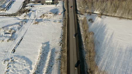 The car traffic of the suburban highway in winter.