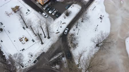 cars follow the road to the parking area in a residential area of the city. Stock mozgókép