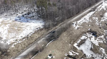 wiper : Jeep picks up speed on a country road. Aerial photography.