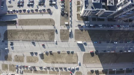 auto parking : Flying over the rooftops. Birds-eye view of urban traffic.