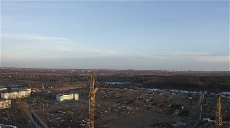 корпус : View from a high-rise crane at a construction site in a new residential area.